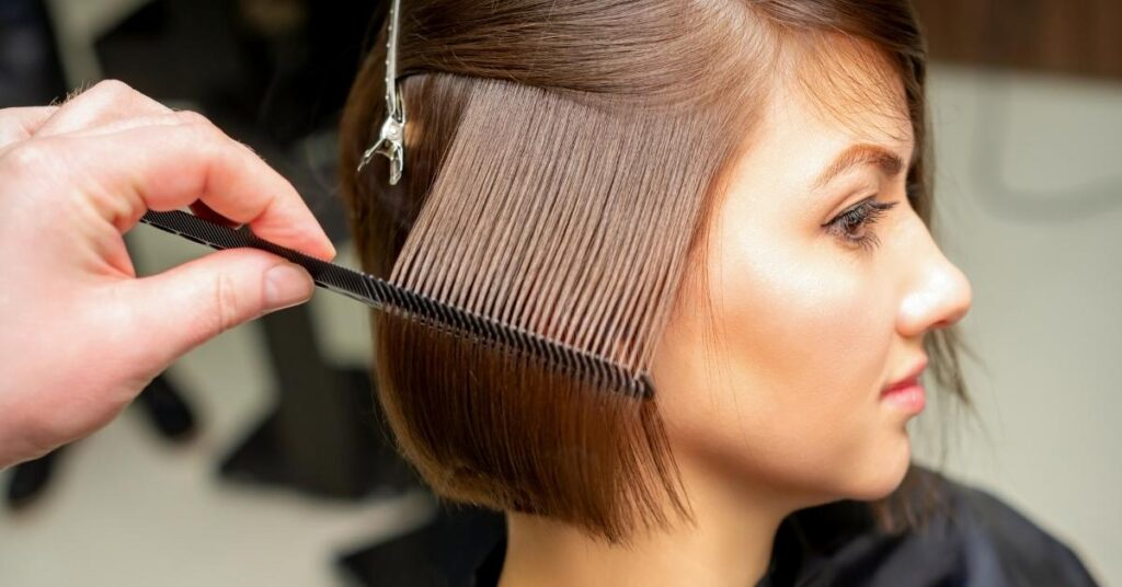 after hair transplant woman comb