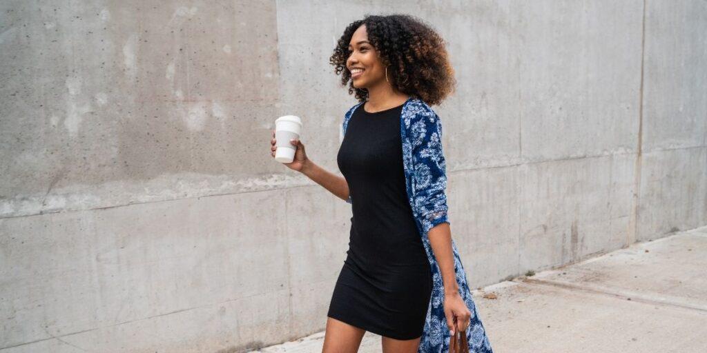 black afro hair type female walks