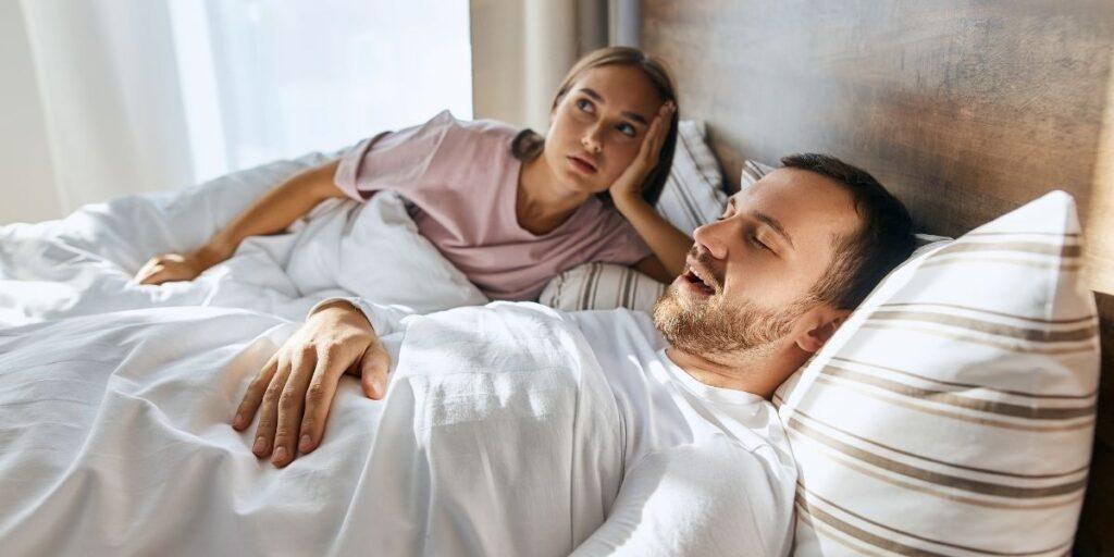 man back sleeping and woman
