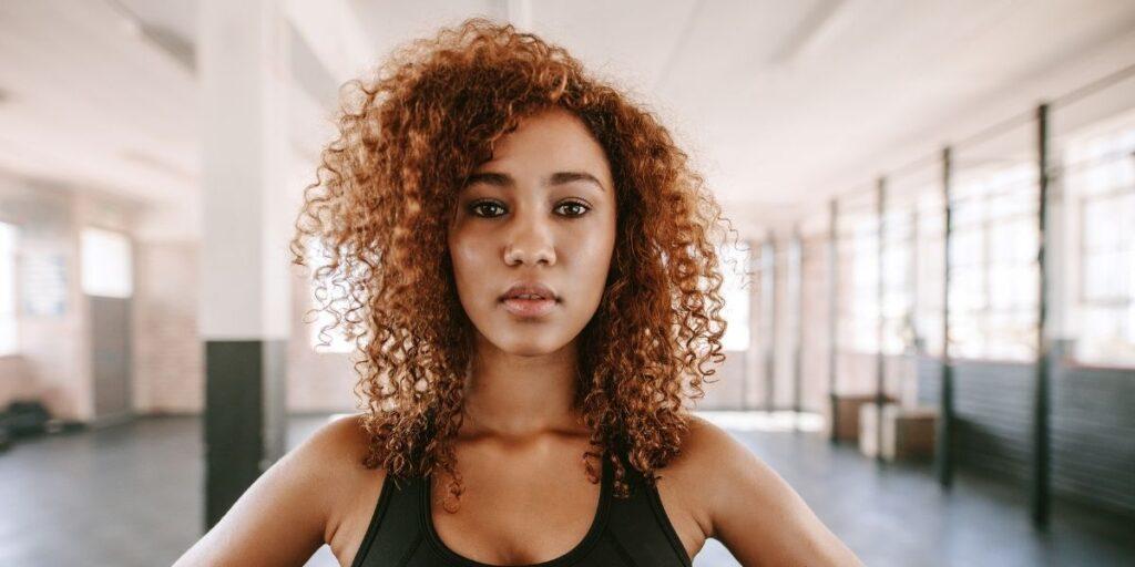 afro woman dense low hair line