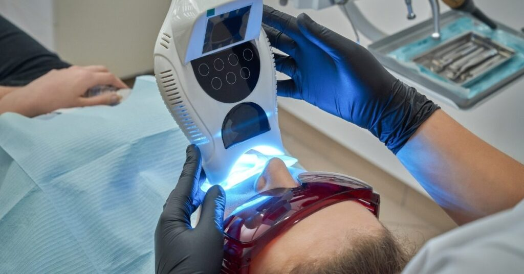 dental whitening process at clinic