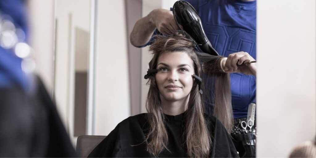 young woman at hair dresser