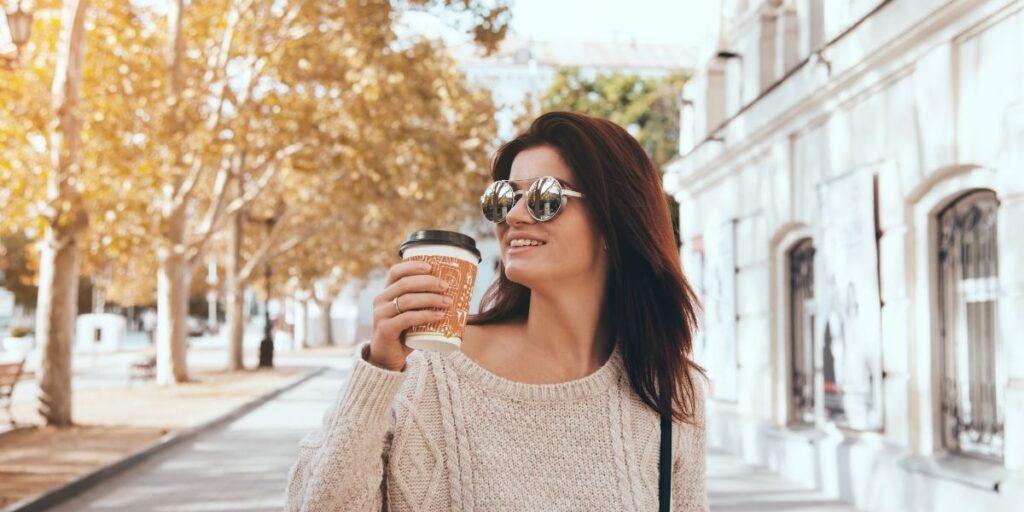 woman drinking coffee on the street